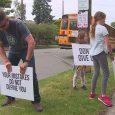 Washington State man posts suicide prevention signs around town