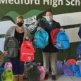 Hundreds of Medford students get free backpacks and supplies